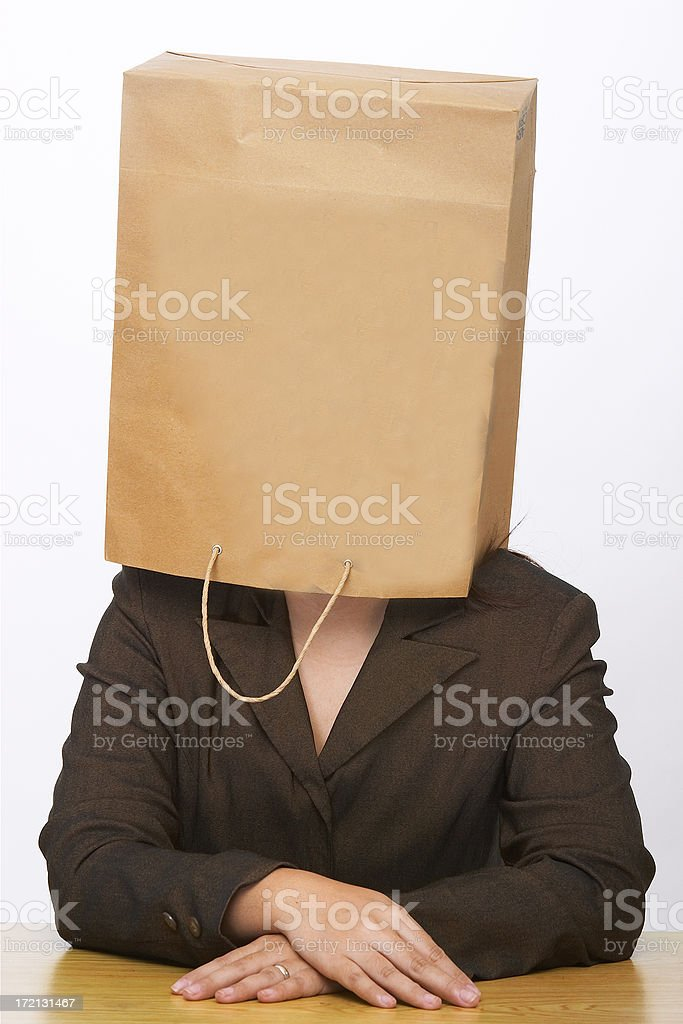 woman with paper bag over her head royalty-free stock photo