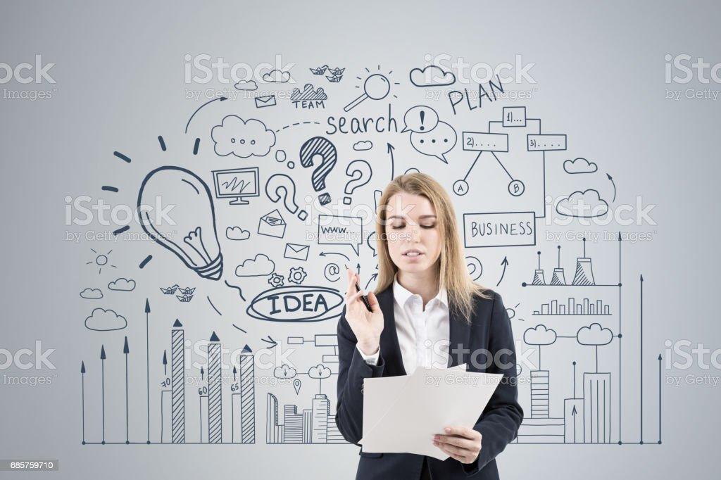 Woman with papers and business idea zbiór zdjęć royalty-free