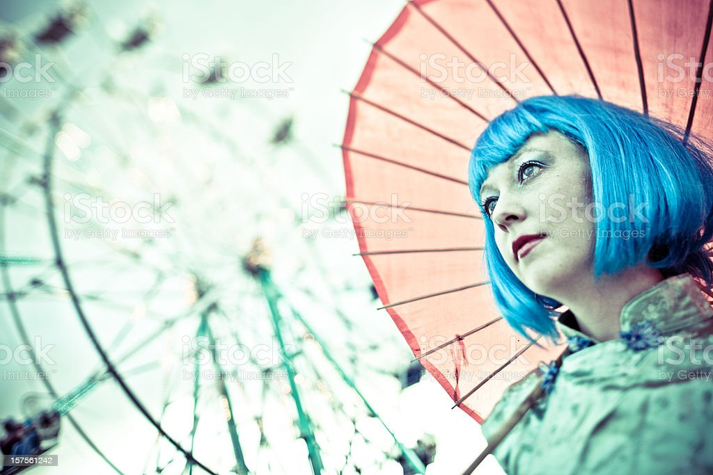 Woman with parasol at the fair royalty-free stock photo