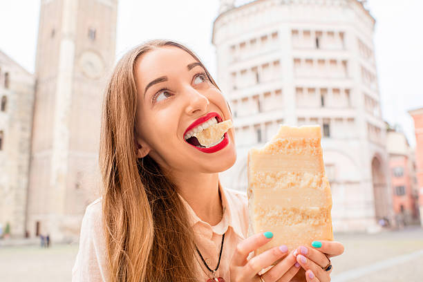 Woman with parmesan cheese in Parma stock photo