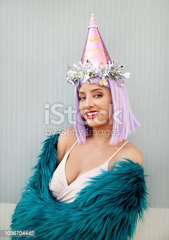 istock Woman with party hat 1036704442