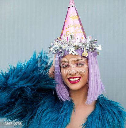 istock Woman with party hat 1036712756