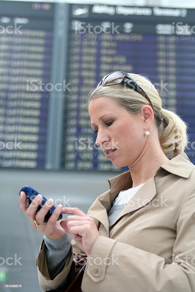 Woman with pda at the airport royalty-free stock photo