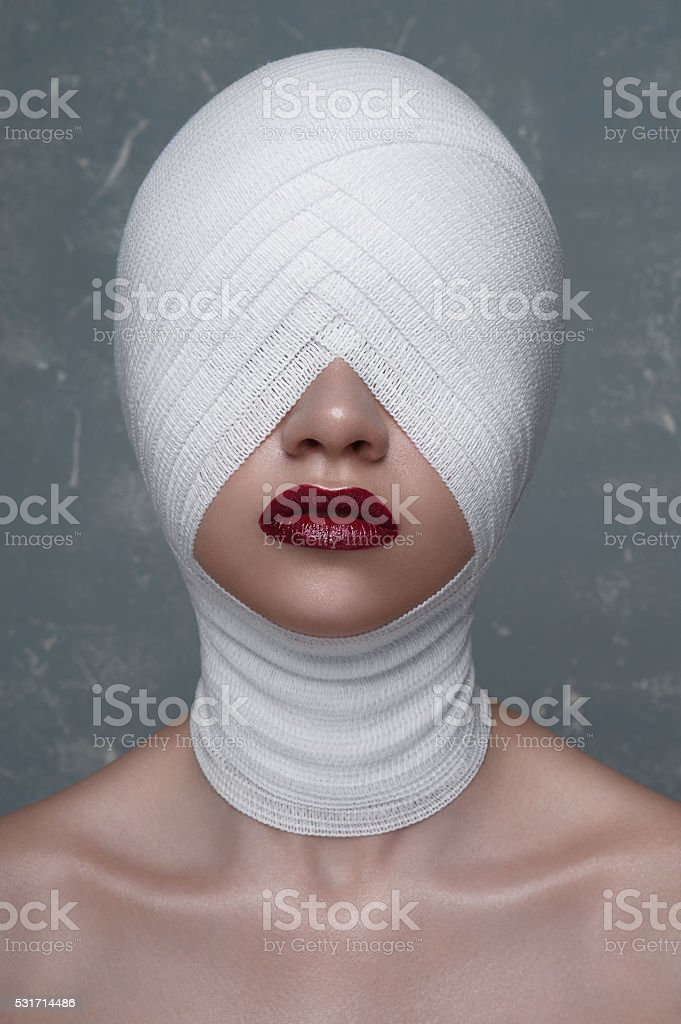Woman with perfect Skin and Bandage on her Head stock photo