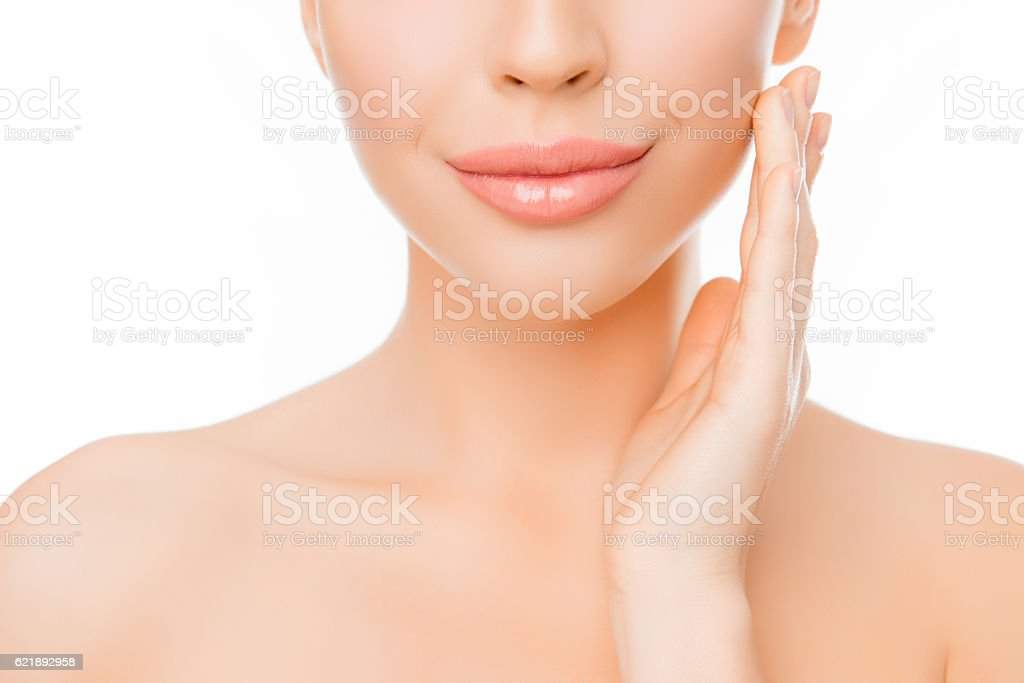 woman with perfect skin applying cream on face stock photo