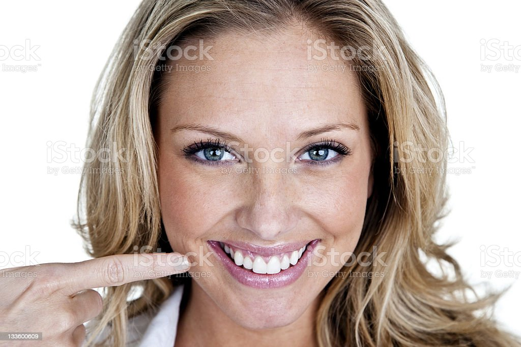 Woman with perfect smile pointing to her teeth royalty-free stock photo