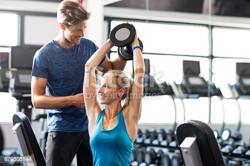 istock Woman with personal trainer 679305144