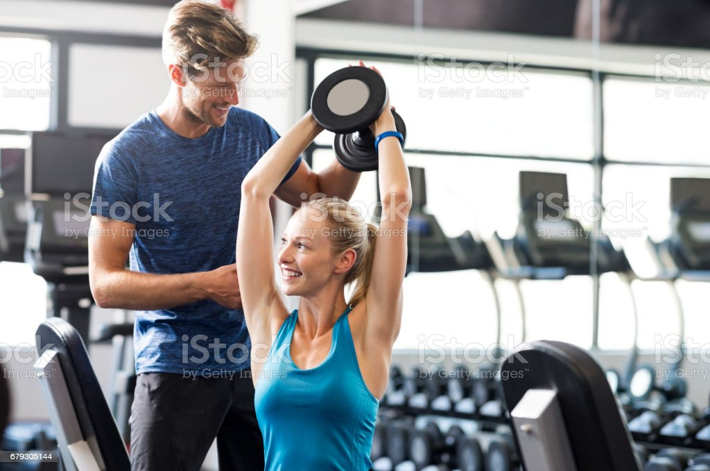 Woman with personal trainer stock photo
