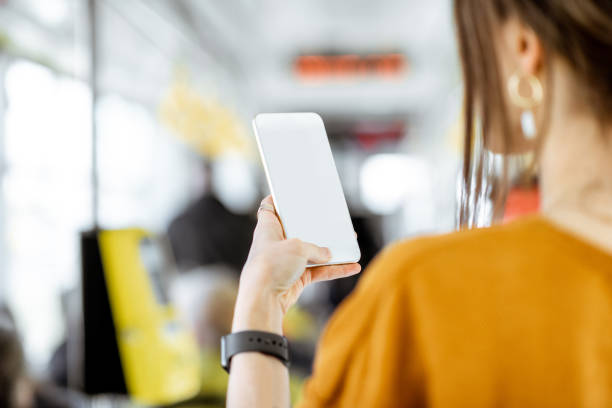 woman with phone at the public transport - phone, travelling, copy space imagens e fotografias de stock