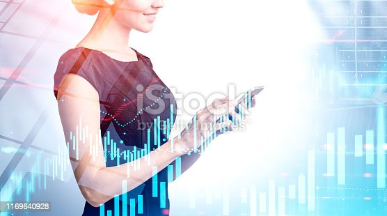 895493084 istock photo Woman with phone, skyscraper and graphs 1169640928