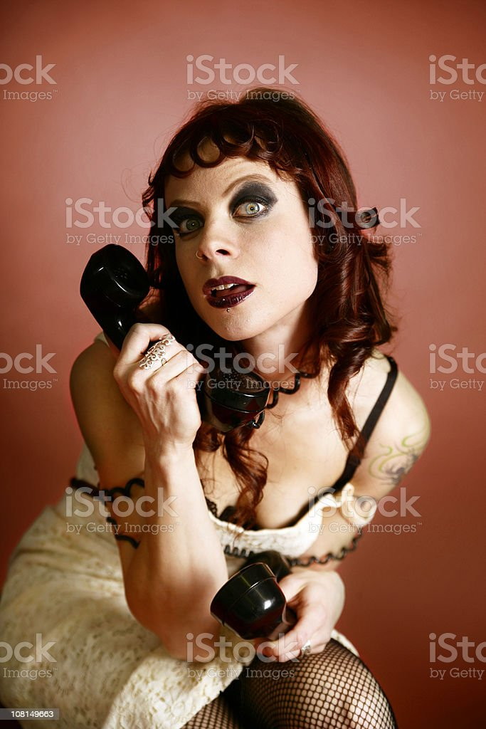 Woman with phones royalty-free stock photo