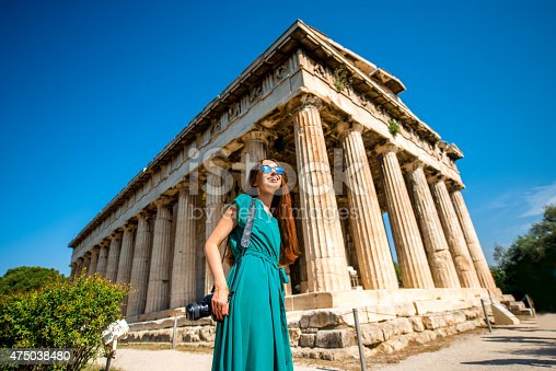 istock Woman with photo camera near Hephaistos temple in Agora 475038480