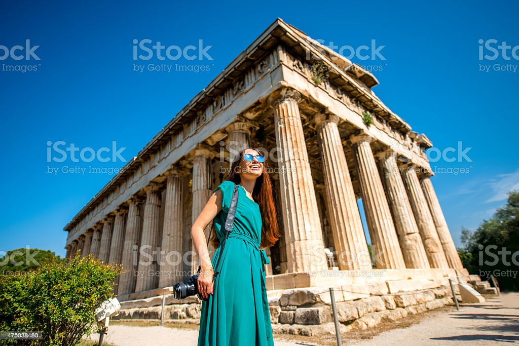 Woman with photo camera near Hephaistos temple in Agora stock photo