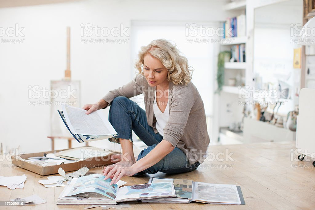 Woman with photograph album and scrapbook stock photo