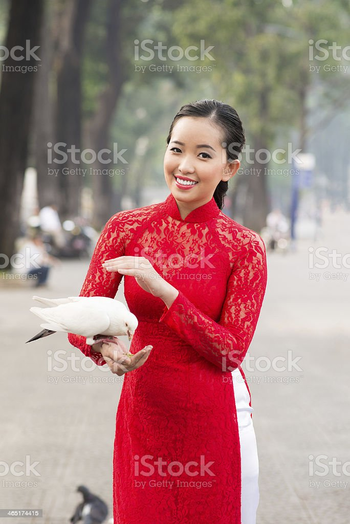 Woman with pigeon stock photo