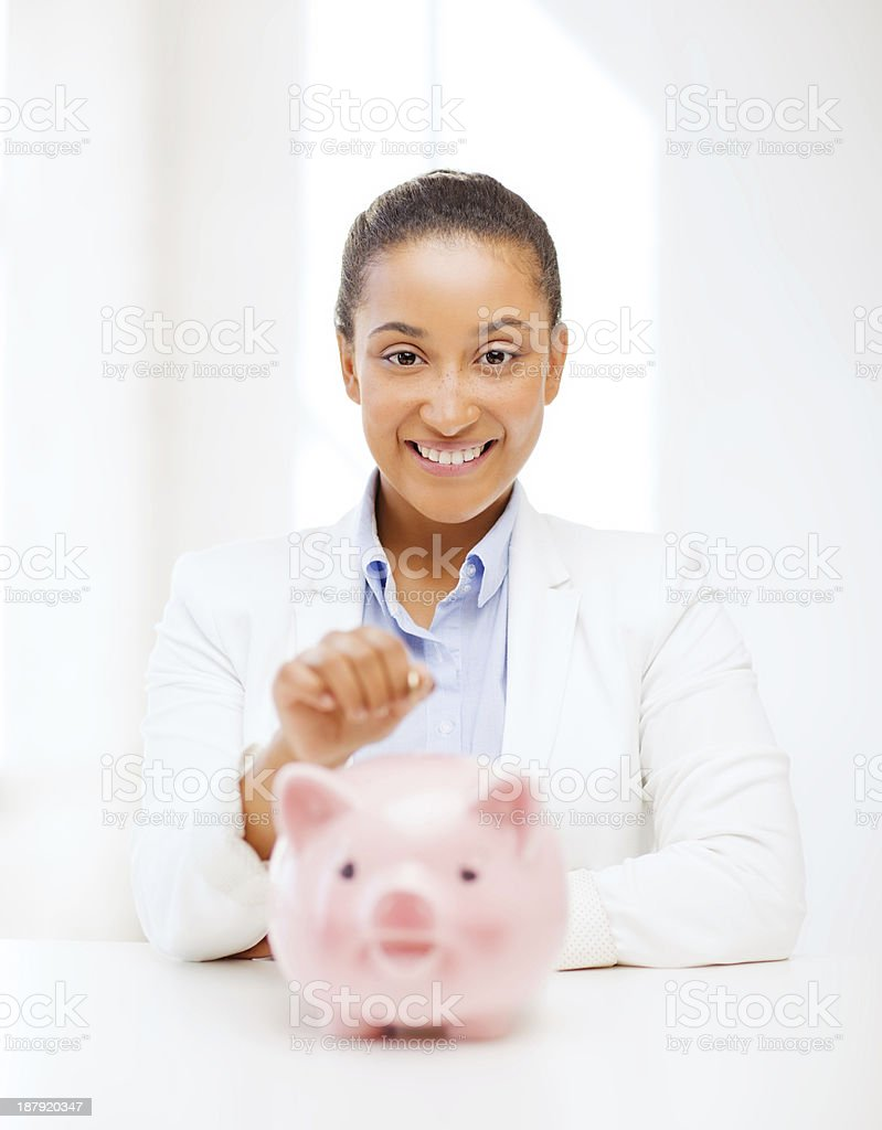 woman with piggy bank and coin royalty-free stock photo