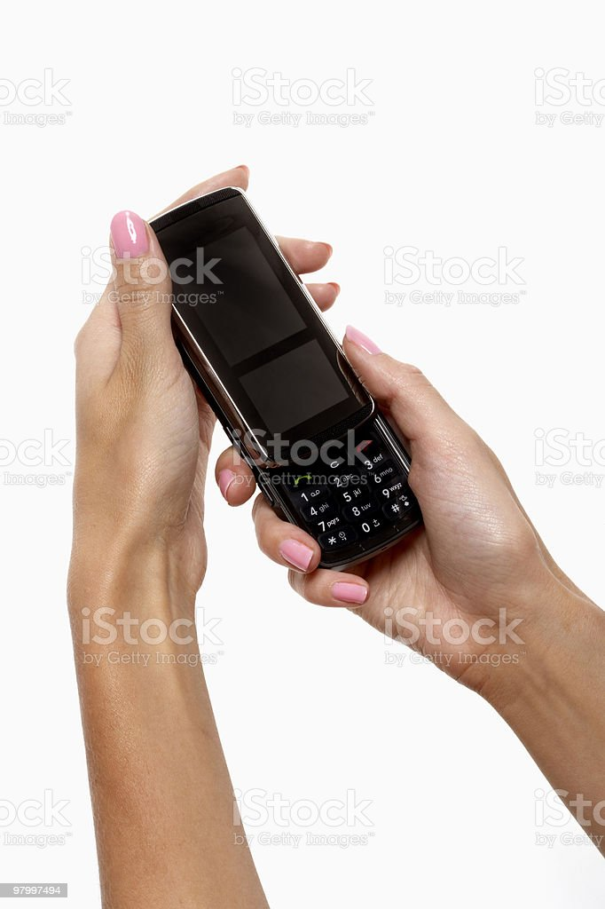 woman with pink nails holding mobile phone royalty free stockfoto