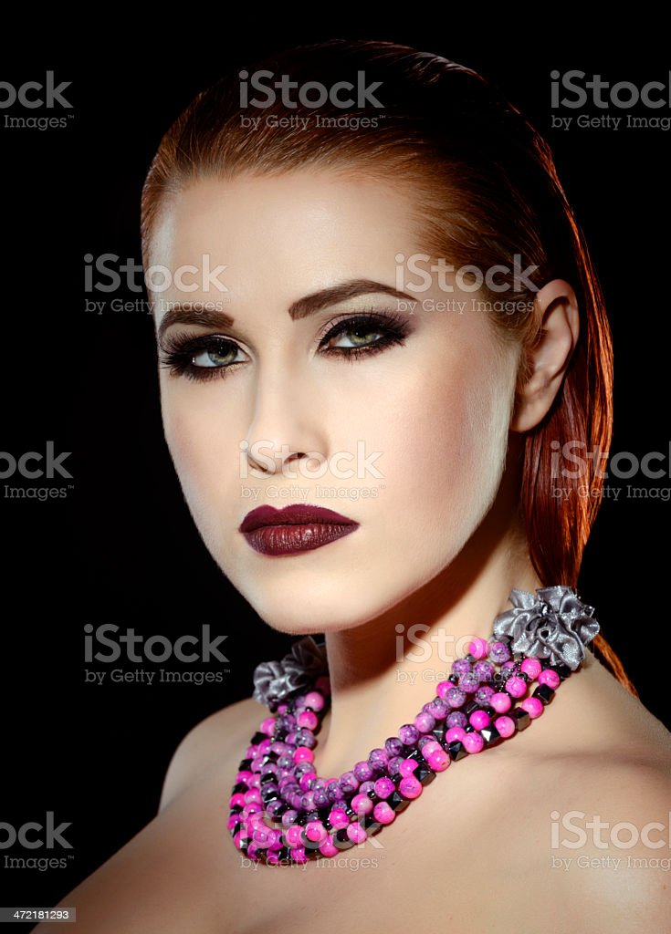 woman with pink necklace royalty-free stock photo