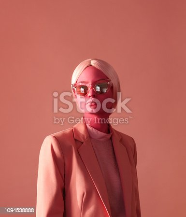 istock Woman with pink skin and pink eye glasses 1094538888