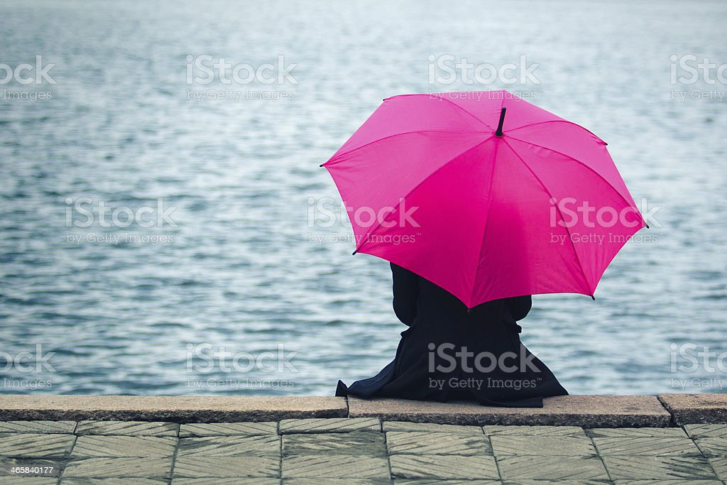 Woman with pink umbrella stock photo