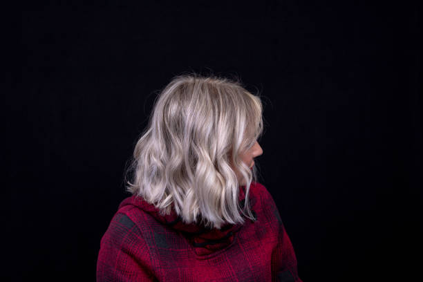 woman with platinum blunt shoulder length bob hairstyle - medium length hair stock photos and pictures
