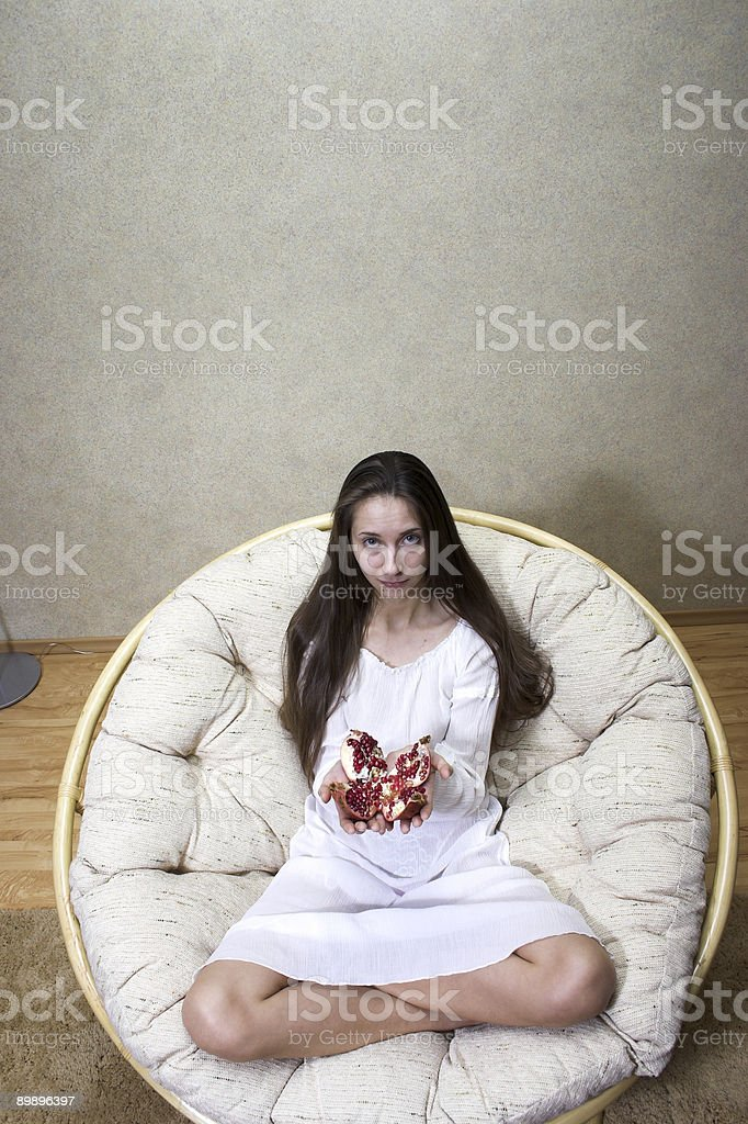 woman with pomegranate royalty-free stock photo