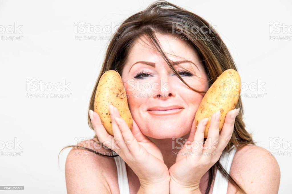 Woman with potatoes stock photo