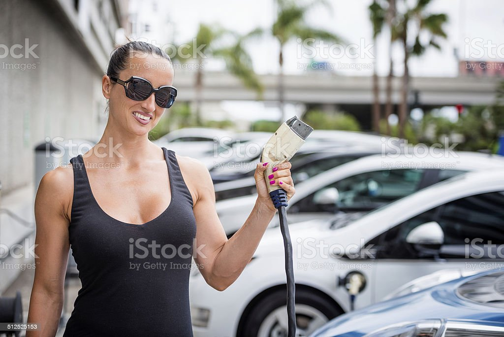 Woman with power cord stock photo