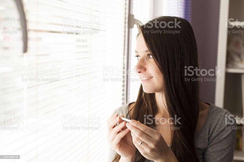 Woman with pregnancy test stock photo