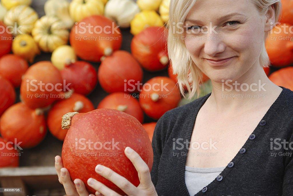woman with pumpkin royalty free stockfoto