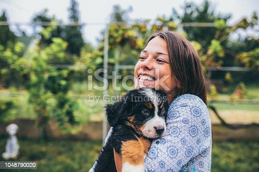 istock Woman with puppies 1048790020