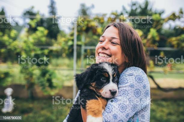 Woman with puppies picture id1048790020?b=1&k=6&m=1048790020&s=612x612&h=5d16h7o1fd39bfdw0hqmzu32yv ahr7xb35pl7b5lkw=