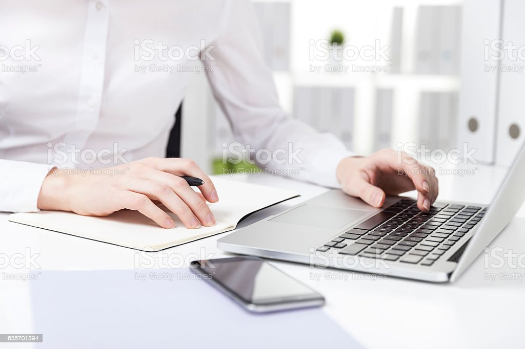 Woman with purple paper typing royalty-free stock photo