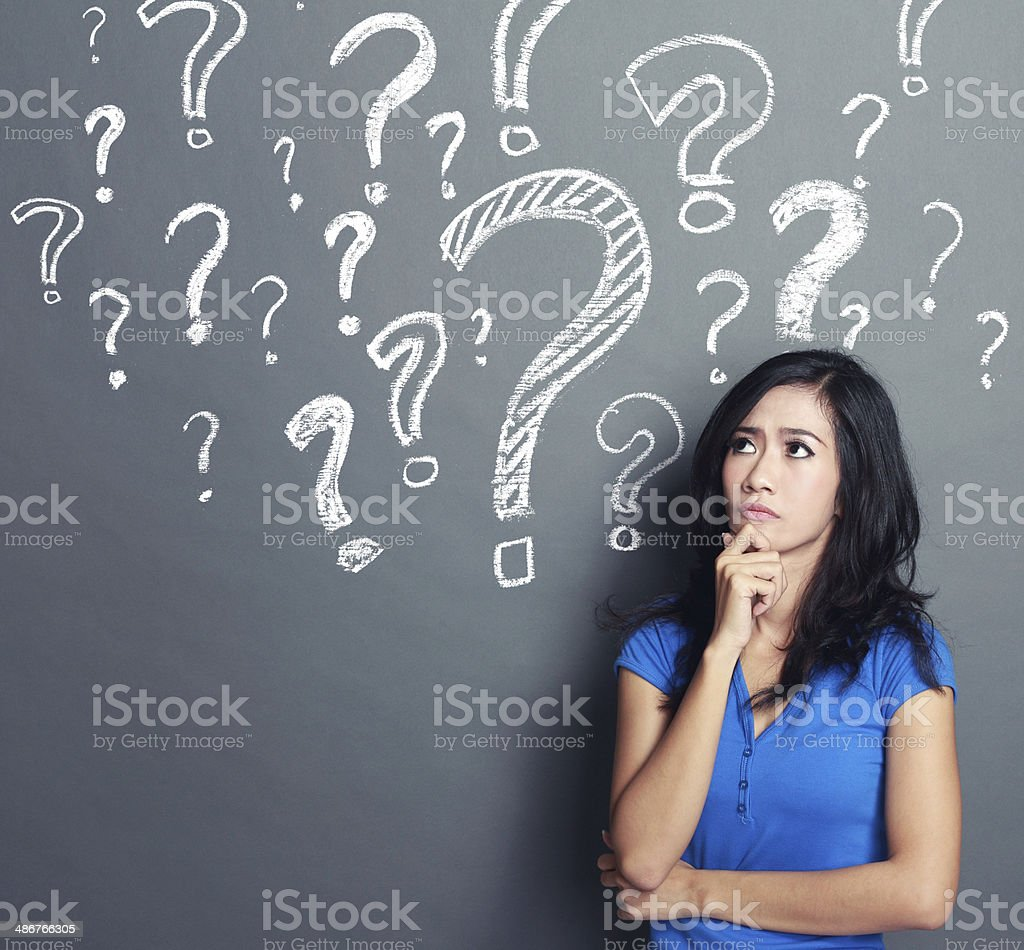 woman with question mark stock photo