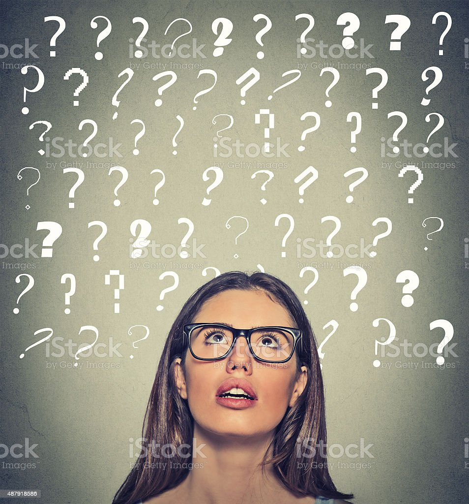 woman with question marks above her head looking up stock photo