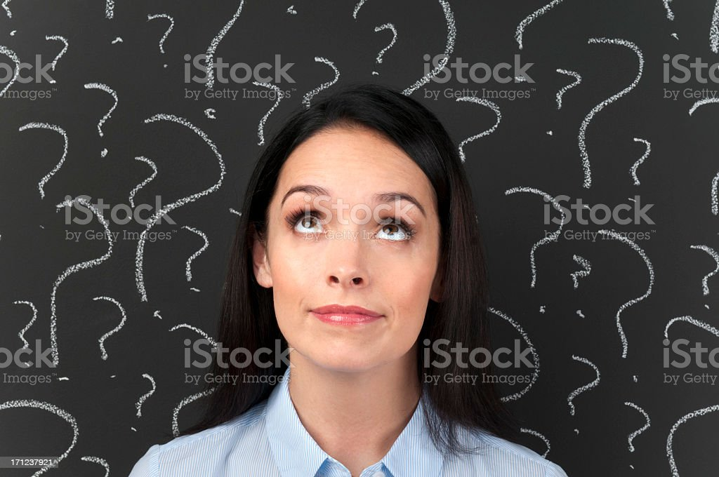 Woman with question marks on a blackboard royalty-free stock photo
