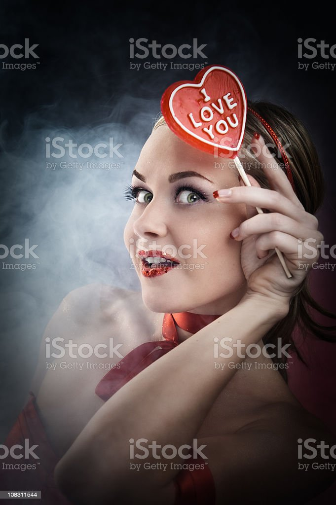 """Woman with """"I love you"""" candy royalty-free stock photo"""