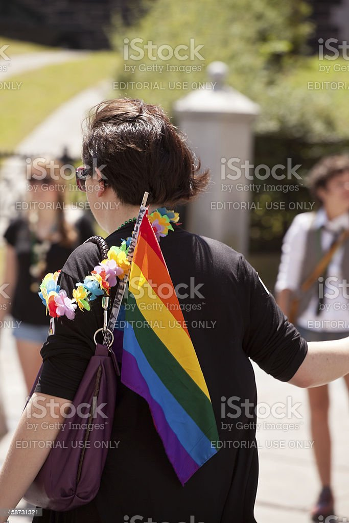 Woman With Rainbow Flag Walking royalty-free stock photo