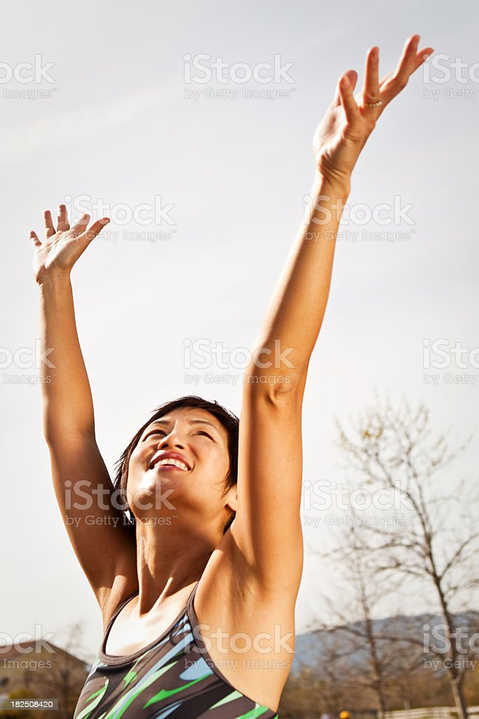 Woman with raised hands royalty-free stock photo