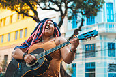 Colored hair, Afro woman, Singing, Guitar, City street