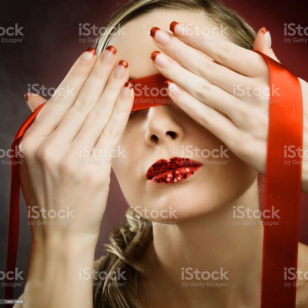 Woman with red blindfold royalty-free stock photo