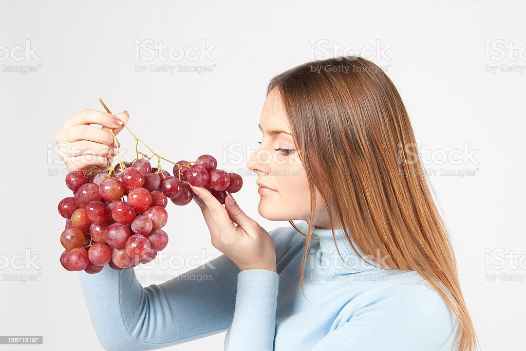 woman with red grapes royalty-free stock photo