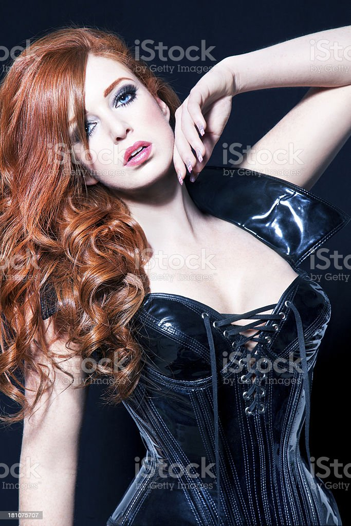 Woman With Red Hair And Black Corset royalty-free stock photo