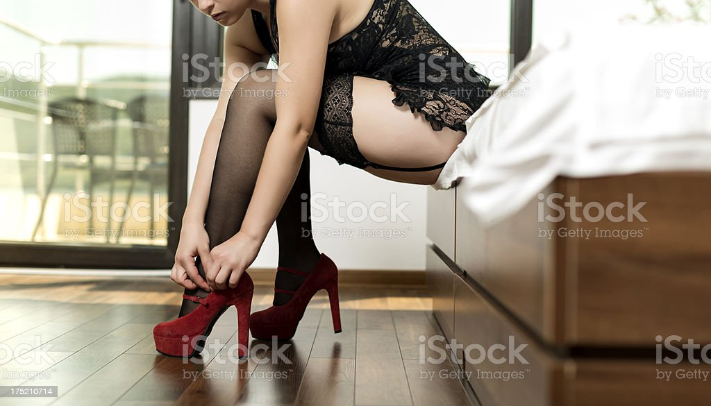 woman with red high heels stock photo