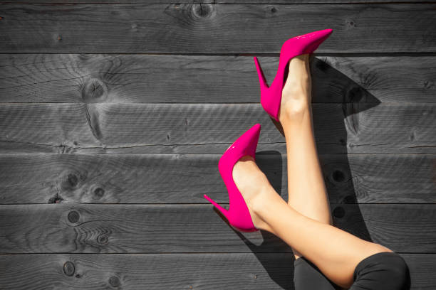 woman with red high heels - human foot stock photos and pictures