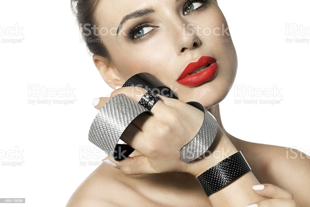 Woman With Red Lipstick And Modern Jewelry stock photo