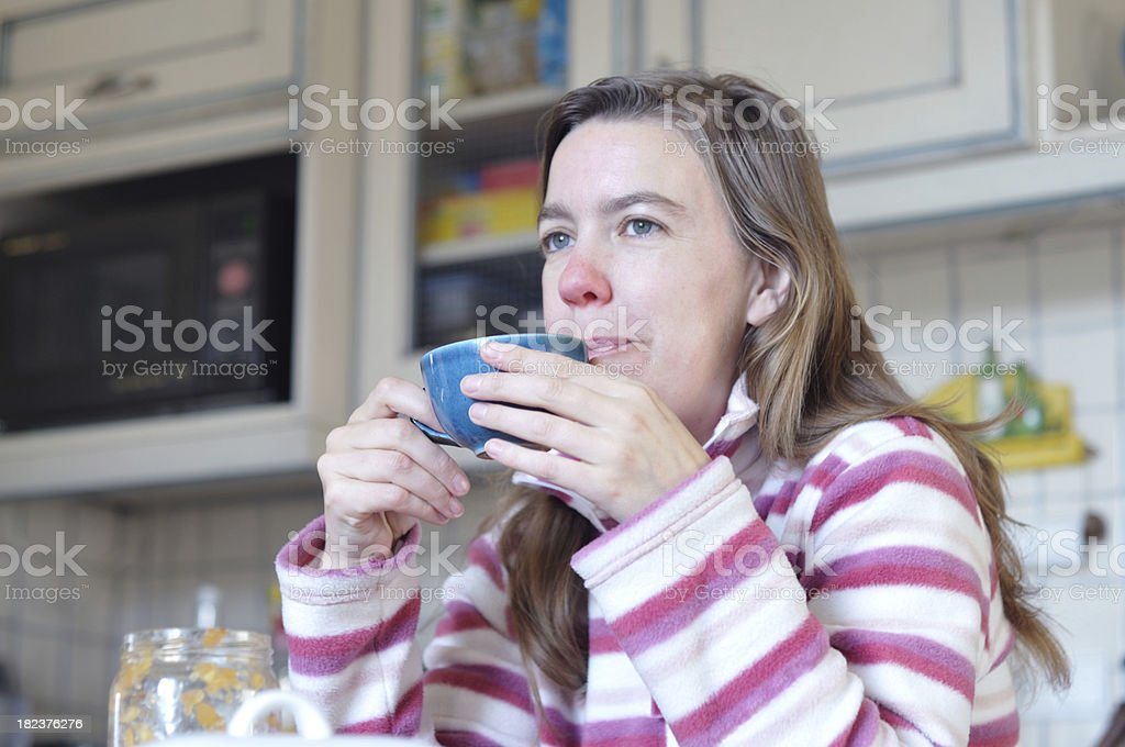 woman with red nose drinking royalty-free stock photo
