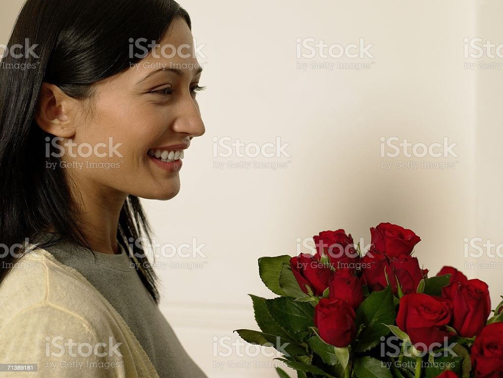 Woman with red roses royalty-free stock photo