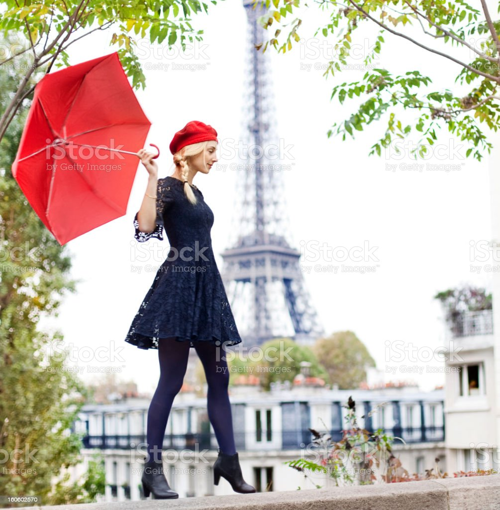 Woman with red umbrella near Eiffel Tower stock photo