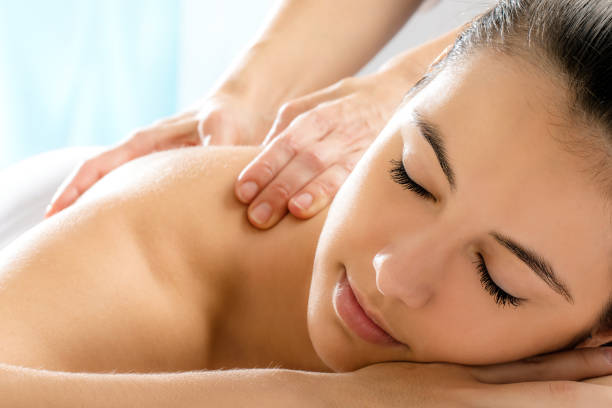 Woman with relaxing face expression in spa. stock photo